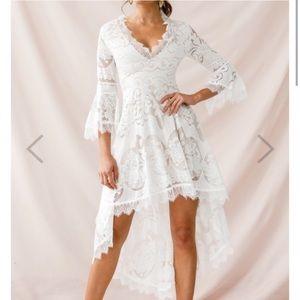 Selfie Leslie bohemian white lace dress.